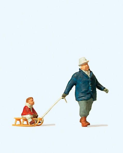 Preiser 28078 - H0 - Mann mit Kind auf Schlitten